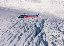The Helicopter Line flying over crevasses