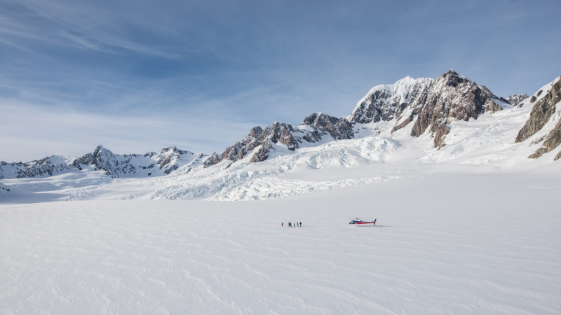 The Helicopter Line West Coast Neve Landing on a Glacier