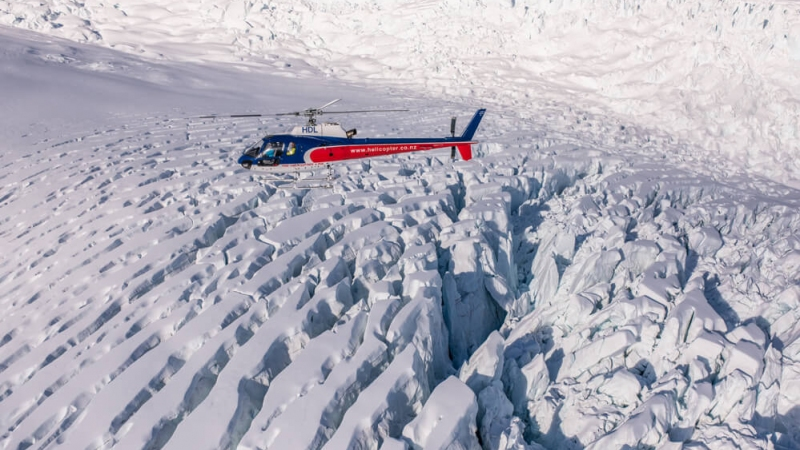 The Helicopter Line West Coast Flying Over Glacial Crevasses